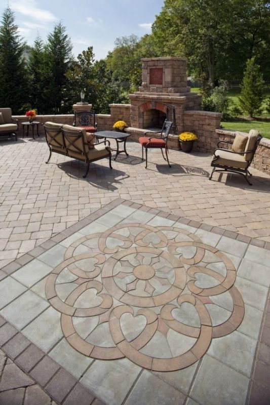 Sutherland Landscape amazing backyard pavers design creates stunning patio area with outdoor oven fireplace and low walls