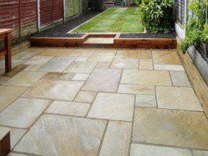 Flagstone patio small yard design by Sutherland Landscape