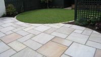 Patio pavers with great grass edge design by Sutherland Landscape