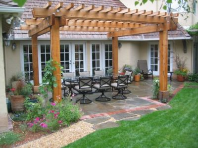Great patio with pergola by Sutherland Landscape