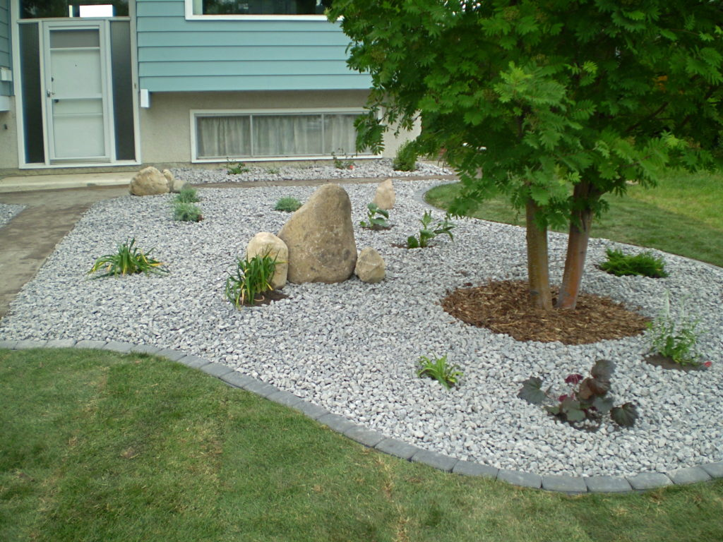Sutherland Landscape xeriscape pebble garden with large boulders creates a striking low maintenance yard