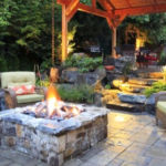 Raised fire pit, stone patio and landscaped pergola by Sutherland Landscape