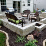 Sutherland Landscape backyard patio inspiration using pavers and low retaining walls to create usable backyard space in Northern California low-maintenance back yard
