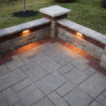 Sutherland Landscape use of pavers and low retaining walls with lighting to create stylish backyard spaces