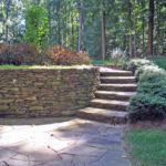 Sutherland Landscape rock retaining wall and steps with paver patio area