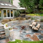 flagstone patio inspiration by Sutherland Landscape