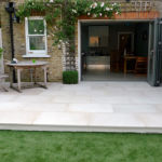 new raised stone patio by Sutherland Landscape